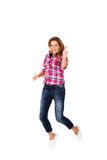 Happy young woman jumping giving thumbs up Royalty Free Stock Image