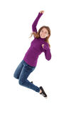 Happy young woman jumping Stock Image