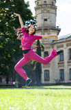 Happy young woman jumping in park Royalty Free Stock Photography