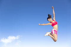 Happy young woman jumping in the sky Stock Images