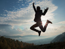 Happy young woman jumping at the sunset Royalty Free Stock Photo
