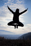 Happy young woman jumping at the sunset Royalty Free Stock Photos