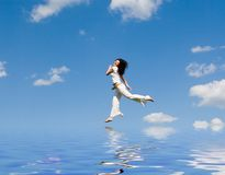 Happy young woman jumping on the water Royalty Free Stock Photography