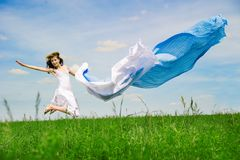 Happy young woman jumps Stock Images