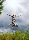 Happy young woman jumps Stock Photography