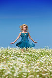 The happy young woman jumps in the field Royalty Free Stock Photography