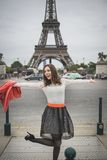 Happy young woman jumps near eifel tower Paris Stock Images