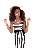 Happy young woman in jumpsuit. Stock Photo