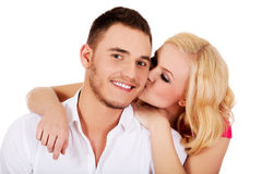 Happy young woman kissing her boyfriend Royalty Free Stock Photography