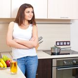 Happy young woman in a kitchen Royalty Free Stock Photography