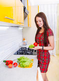 Happy young woman in the kitchen Stock Photography