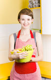 Woman with bowl of fruit Royalty Free Stock Photos