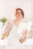 Happy young woman in the kitchen Royalty Free Stock Photo