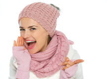 Happy young woman in knit winter clothing Stock Photo