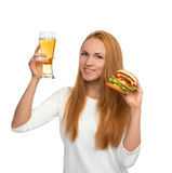 Happy young woman with lager beer mug and burger sandwich hambur Royalty Free Stock Photos