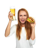 Happy young woman with lager beer mug and burger sandwich hambur Royalty Free Stock Photo