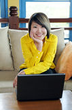 Happy young woman with laptop Royalty Free Stock Image