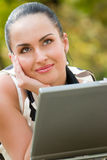 Happy young woman with laptop Royalty Free Stock Photography