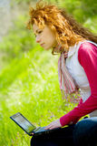 Happy young woman with laptop Stock Photo