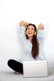 Happy young woman with laptop and earphones Royalty Free Stock Image