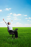 Happy young woman with laptop on the meadow. Bright picture of happy young woman with laptop on the meadow Stock Photos
