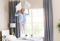 Free Happy Young Woman Laughing And Jumping On The Bed In   Morning At Home Stock Images - 170632254