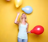 Happy young woman laughing with balloons Stock Photo