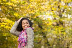 Happy young woman laughing with hand in hair Stock Images