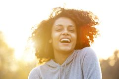 Happy young woman laughing outdoors Stock Images