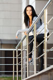 Happy young woman leaning on handrail Stock Photos