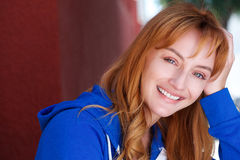 Happy young woman leaning head on hand Stock Photos