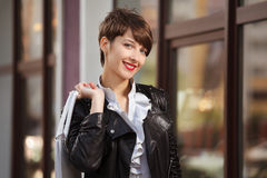 Happy young woman in leather jacket Royalty Free Stock Photo