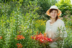 Happy young woman in lily plant Royalty Free Stock Images