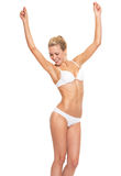 Happy young woman in lingerie dancing Stock Photo