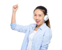 Happy young woman listen to music by headphone Stock Photos