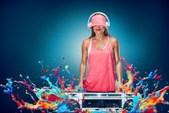 Happy young woman listening music with boombox. Against liquid splash explosion background Royalty Free Stock Image