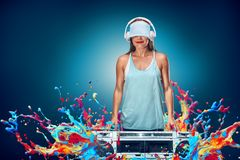 Happy young woman listening music with boombox Stock Images