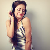 Happy young woman listening the music from headphones with close Stock Image