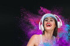 Happy young woman listening music in headphones Royalty Free Stock Photography
