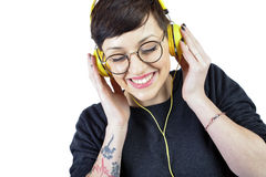 Happy young woman listening music in headphones Stock Image