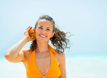 Happy young woman listening sound of sea Stock Photo