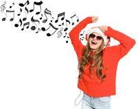 Happy young woman listening to Christmas music. On white background stock photo