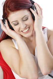 Happy young woman listening to music Stock Photography