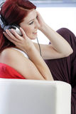 Happy young woman listening to music Royalty Free Stock Photography
