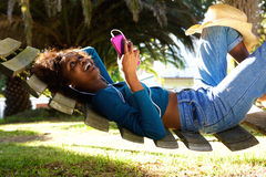 Happy young woman listening to music with cell phone Royalty Free Stock Photos