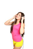 Happy young woman listening to music with closed eyes on white b Royalty Free Stock Photography