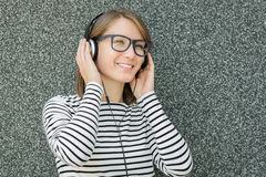 Happy young woman listening to music with headphones Stock Photo