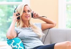 Happy young woman listening to music on headphones Stock Photography