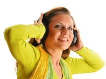 Happy young woman listening to the music in headphones isolated Royalty Free Stock Photos