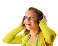 Happy young woman listening to the music in headphones isolated Stock Image